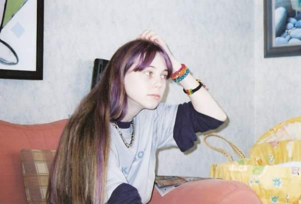 Me about 17 with purple hair and a bike chain necklace